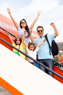 Tips for flying with kids who need a car seat